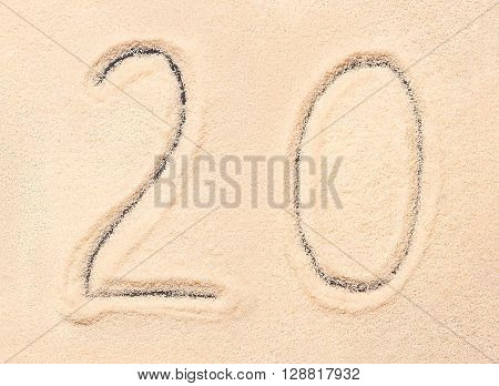 20 number written on sand, summer beach background