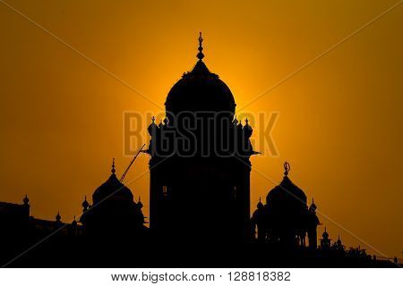 Silhouette Amritsar Golden Temple in India at sunset