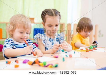 kids group doing arts and crafts in day care centre