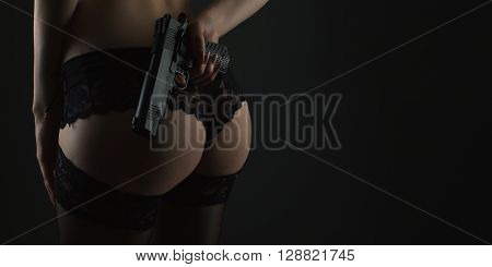 Erotic Back View Of A Female Body With  Gun
