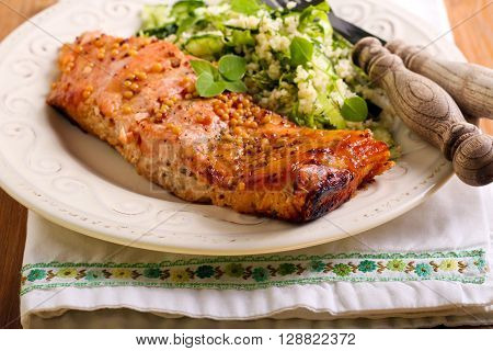 Mustard and honey glazed salmons and salad aside