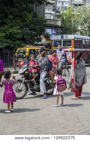 MUMBAI, INDIA - OCTOBER 9, 2015: Unidentified Indian family rides a motorbike. Motorbike is the most favorite vehicle and most affordable in India.