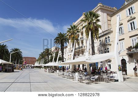 SPLIT, CROATIA - SEPTEMBER 18, 2015: Tourists on the Riva (sea promenade) on a summer day. Split is popular touristic coastal destination in Croatia.