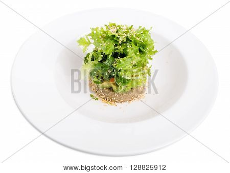 Quinoa salad with avocado and cherry tomatoes. Isolated on a white background.