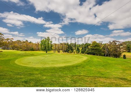 Katoomba, Australia - November 10, 2014: View of Golf course with a bunker and a good green in a nice day, Katoomba, New South Wales, Australia.