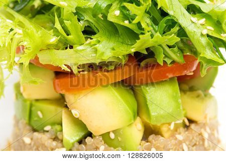 Delicious quinoa salad with avocado and cherry. Macro. Photo can be used as a whole background.