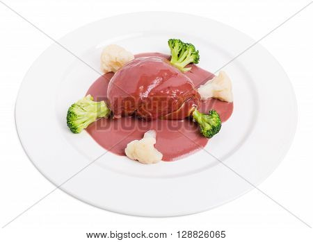 Chicken breast with foie gras covered with delicious beet mousse and vegetables. Isolated on a white background.