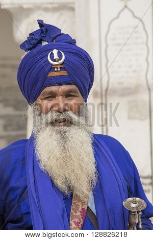 AMRITSAR INDIA - SEPTEMBER 26 2014: Unidentified Sikh man visiting the Golden Temple in Amritsar Punjab India. Sikh pilgrims travel from all over India to pray at this holy site.
