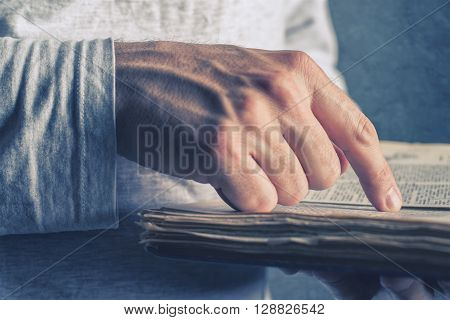 Close up of adult male hands holding vintage book man reading