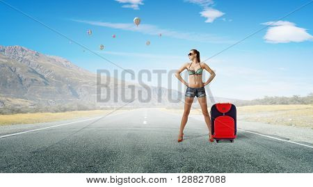 Hitch hiker woman on road