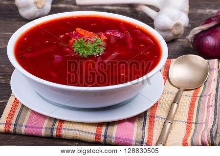 Ukrainian and russian national food - red beet soup borscht . Close up