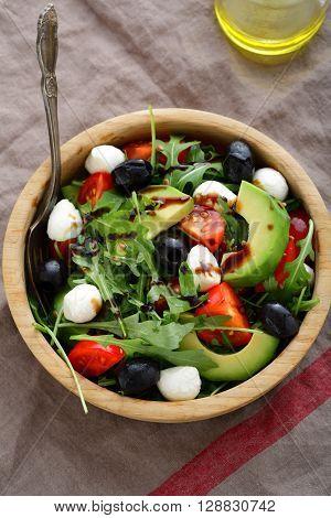 Fresh Avocado Salad With Mozzarella, Tomatoes, Olive And Arugula