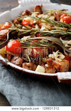 Roast Beef Meat With Rosemary, Tomato And Onion On Frying Pan