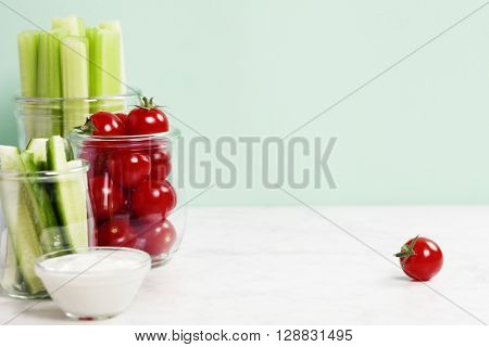 assorted fresh vegetables with dip on blue background - Vegan, Vegetarian, Healthy food