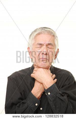 senior Japanese man having throat pain on white background