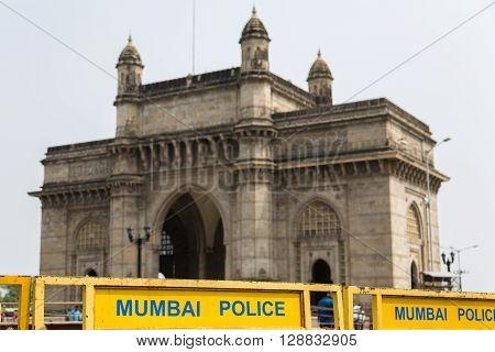 Mumbai police signage in front of the Gateway of India in Mumbai