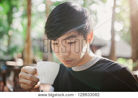 A Man Drinking On The Morning Coffee In Sunshine Light