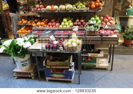 FLORENCE ITALY - CIRCA APRIL 2016: fruit and vegetables on display on a fruit shop counter