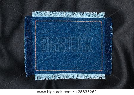 Frame made of denim fabric with yellow stitch on black silk with space for your text view from above
