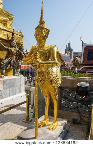 BANGKOK, THAILAND - JANUARY 24, 2015: Demon guardian in Wat Phra Kaeo Bangkok. Wat Phra Kaew is one of the most popular tourists destination in Thailand