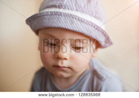 Portrait of sad little boy looking down ** Note: Soft Focus at 100%, best at smaller sizes