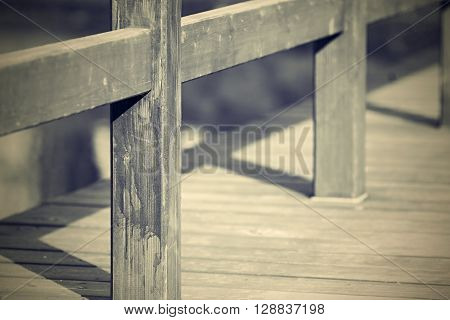 design of the wooden floor or platform with a handrail closeup and blank space in retro style