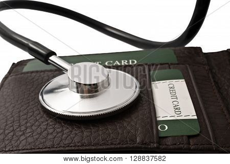 Diagnose finance situation, a stethoscope on wallet.