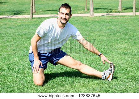 Man at the park doing stretching exercises