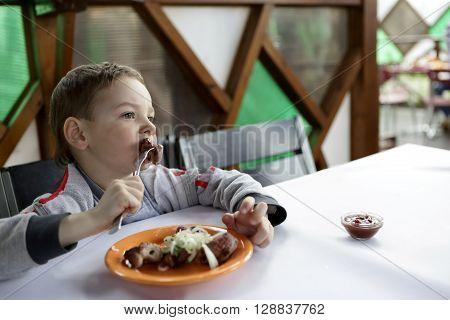 Child Eating Kebab
