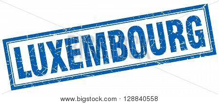 Luxembourg blue square grunge stamp on white