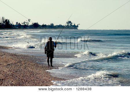 Fisherman On Beach
