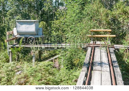 MILLWOOD SOUTH AFRICA - MARCH 4 2016: A mine-cart and track at the historic Bendigo gold mine at Church Millwood. All mining operations stopped in 1892