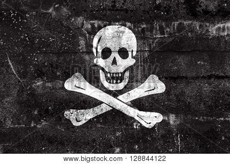 The Traditional Jolly Roger Of Piracy Flag, Painted On Dirty Wall. Vintage And Old Look.