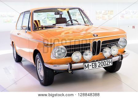 Munich Germany April 19 2016 - BMW 2002 ti at museum of BMW.The BMW New Class (German: Neue Klasse) was a line of sedans and coupes produced by German automaker BMW between 1962 and 1977.