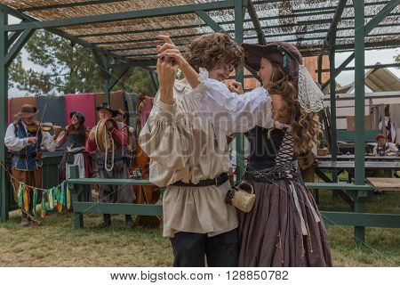 Couple With Medieval Costumes Dancing