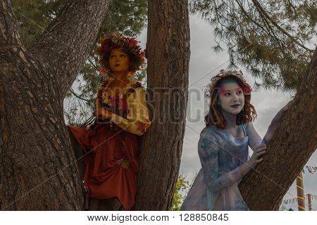 Young Women With Colorful Clothing And Painted Face Showing