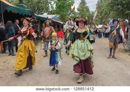 People With Historic Costumes Walking And Singing