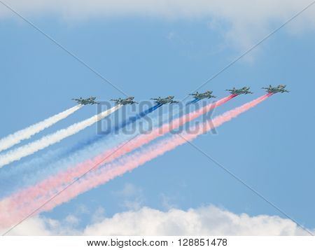 Moscow - May 7 2016: Six Su-25 fired smoke colors of the Russian flag on the aerial part of the Victory Day parade May 7 2016 Moscow Russia