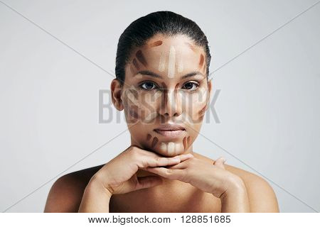 woman with a lines of corrector ona face