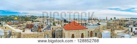 Panoramic view of the old city with the stone domes of the Synagogues and the golden cupola of the Dome of the Rock Jerusalem Israel.