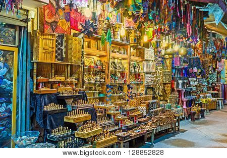 The bright illuminated stall with many diferent handmade souvenirs Jrusalem Israel.