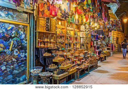 The souvenir stall in Ben Yehuda street offers the handmade wooden chess arabian lights colorful bags and other tourist goods Jerusalem Israel.