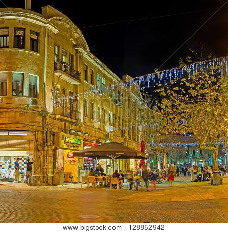 JERUSALEM ISRAEL - FEBRUARY 17 2016: The numerous outdoor cafes in Ben Yehuda street offer tasty local cuisine and beverages on February 17 in Jerusalem.