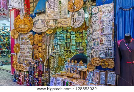 JERUSALEM ISRAEL - FEBRUARY 18 2016: The market stall in Arab Bazaar with the wide range of the wooden pearl and porcelain souvenirs and talismans on February 18 in Jerusalem.