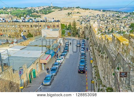 JERUSALEM ISRAEL - FEBRUARY 18 2016: The street along the city rampart from the Zion Gate leads down to the Western Wall on February 18 in Jerusalem.