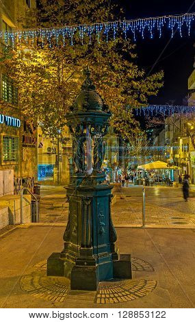 JERUSALEM ISRAEL - FEBRUARY 17 2016: The scenic fountain in Ben Yehuda pedestrian street decorated with the scenic women sculptures on February 17 in Jerusalem.