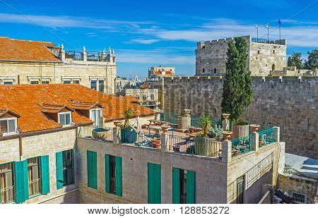 The red tiled roofs of Jerusalem with the ramparts and tower of the David's fortress on the background Israel.