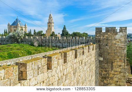 The corner tower of the old city wall and the Dormition Abbey on the background Jerusalem Israel.