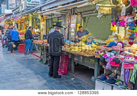 JERUSALEM ISRAEL - FEBRUARY 17 2016: The evening in Mahane Yehuda market - the best place to enjoy Middle Eastern trading traditions and taste various types of local food on February 17 in Jerusalem.
