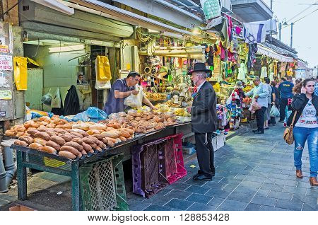JERUSALEM ISRAEL - FEBRUARY 17 2016: The baker's stall in Mahane Yehuda market offers fresh tasty and flavoured bread on February 17 in Jerusalem.